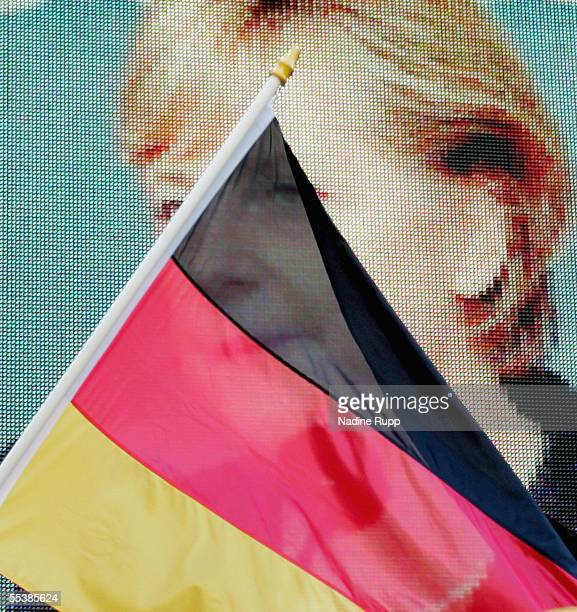 Angela Merkel, top candidate for Chancellor of the conservative opposition and leader of the Christian Democratic Union , appears on a screen while...