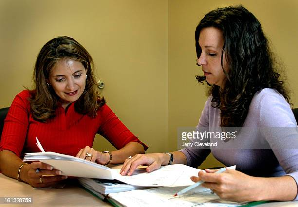 DENVER COLO OCTOBER 1 2004 Angela Ortega <cq> left and Lanette Dairy <cq> of Primer Latino Titulo go over closing papers in PLT's offices in Denver...