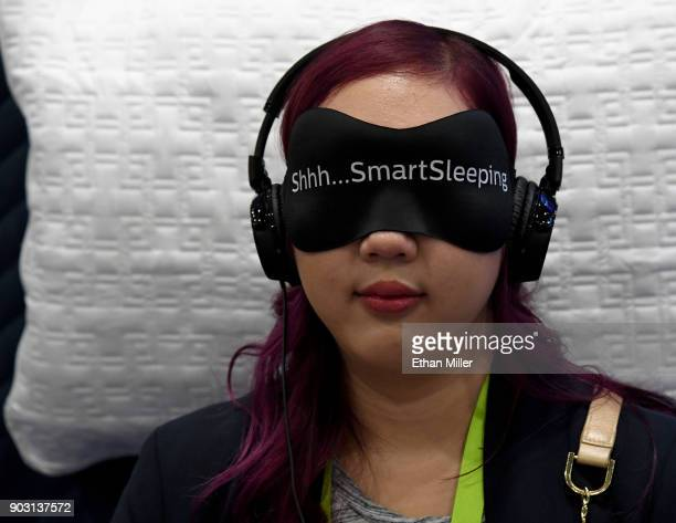 Angela Pan of Minnesota tries the Philips SmartSleep wearable sleep improvement system during CES 2018 at the Sands Expo and Convention Center on...
