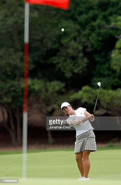 Angela Park watches her approach shot on the first hole during round three of the US Women's Open Championship at Pine Needles Lodge Golf Club June...