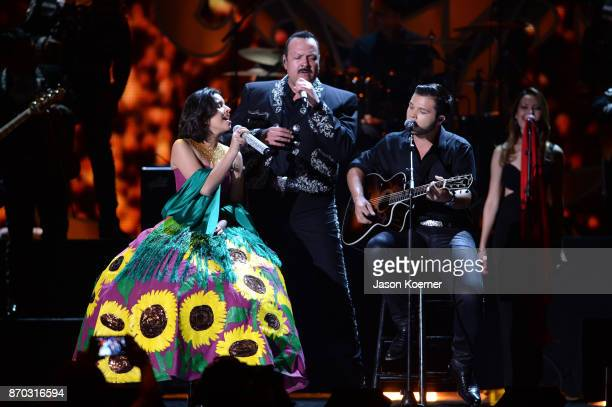 Angela Pepe and Leonardo Aguilar perform onstage during the iHeartRadio Fiesta Latina Celebrating Our Heroes at American Airlines Arena on November 4...