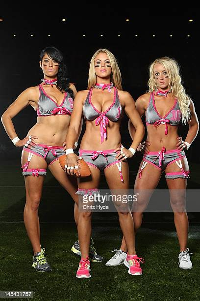 Angela Perfetto Liz Gorman and Ashley Helmstetter of the Eastern conference pose during the Lingerie Football League media call at Brisbane...