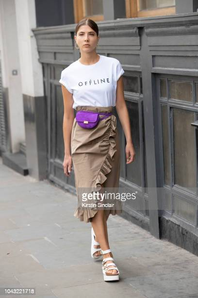 Angela Peruffo wears Offline top W11 Studio skirt and Wandler bag during London Fashion Week September 2018 on September 14 2018 in London England