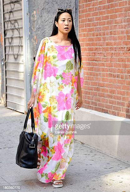 Angela Pham is seen outside the Jeremy Scott show wearing a vintage dress from Ebay on September 11 2013 in New York City