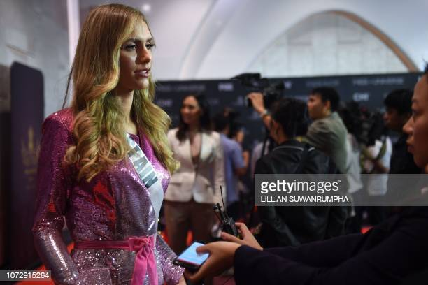 Angela Ponce of Spain speaks during an interview with journalists at a media event of 2018 Miss Universe pageant in Bangkok on December 14 2018...