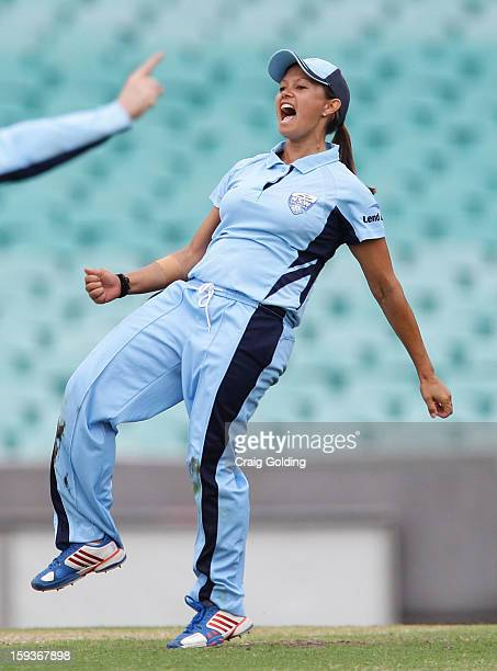 Angela Reakes of the Breakers celebrates after catching Kirby Short off her own bowling during the WNCL Final match between the NSW Breakers and the...
