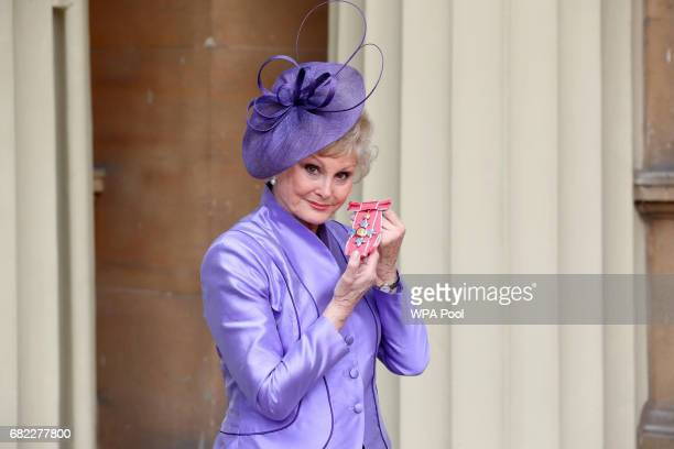 Angela Rippon poses after she was awarded a CBE by the Duke of Cambridge during an Investiture ceremony at Buckingham Palace on May 12 2017 in London...