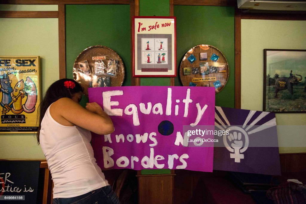 Angela Rojas, one of the organizers of the women's strike in Bangkok posts an 'equality knows no borders' sign in the Cabbages and Condoms restaurant and event space on March 8, 2017 in Bangkok, Thailand. International Women's Day was first marked in 1911 and celebrated each year on 08 March with thousands of events around the world by women's networks.