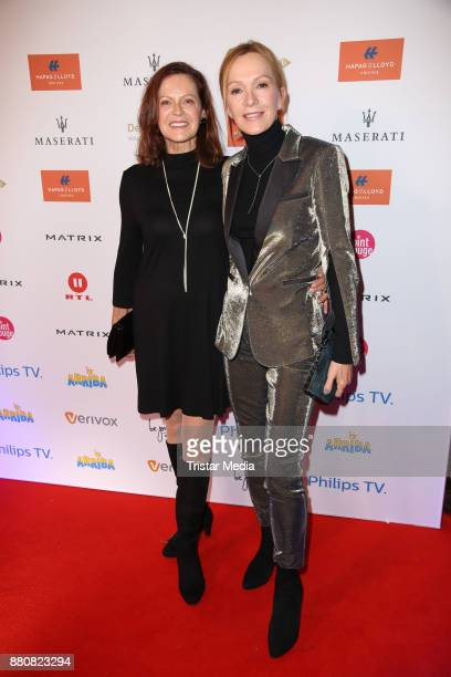 Angela Roy and Katja Flint wearing a golden suit from Karl Lagerfeld attend the Movie Meets Media event 2017 at Hotel Atlantic Kempinski on November...