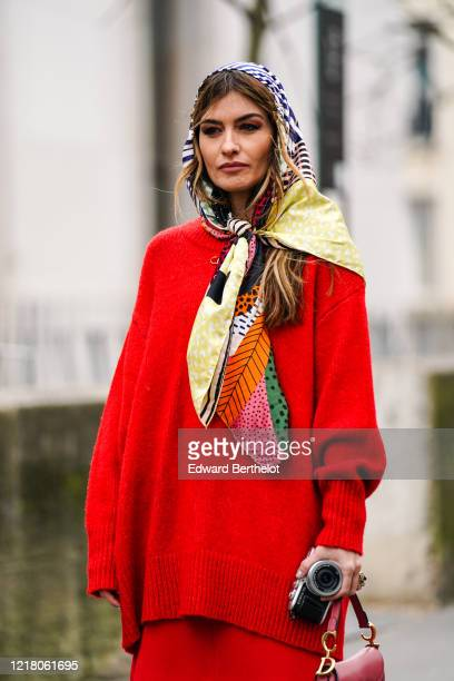 Angela Rozas Saiz wears a Bimba Y Lola scarf over the head a red wool oversize pullover outside Leonard Paris during Paris Fashion Week Womenswear...