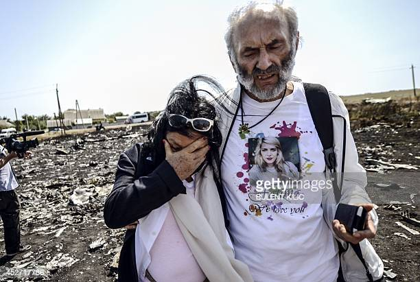 Angela RudhartDyczynski and Jerzy Dyczynski from Australia react as they arrive on July 26 2014 at the crash site of the Malaysia Airlines Flight...