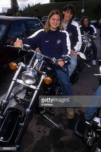 Angela Ruggiero and Cammi Granato of Team USA pose for a portrait sitting on a motorcycle during an off day in August 1997