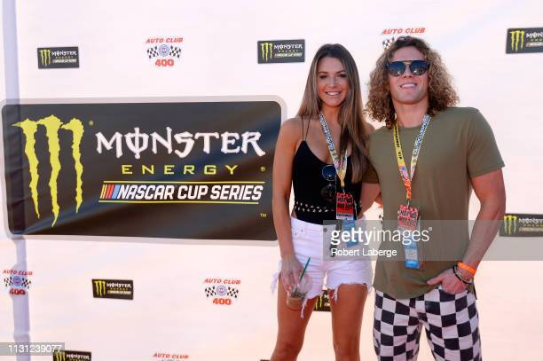 Angela Rummans and Tyler Crispen attend the driver's meeting prior to the Monster Energy NASCAR Cup Series Auto Club 400 at Auto Club Speedway on...