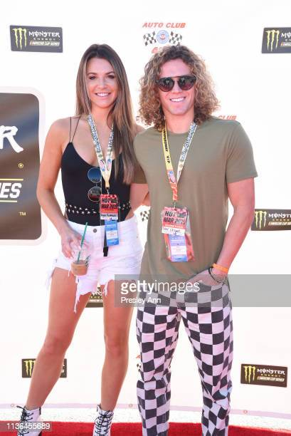 Angela Rummans and Tyler Crispen attend the Monster Energy NASCAR Cup Series race at Auto Club Speedway at Auto Club Speedway on March 17 2019 in...