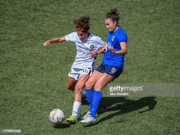Angela Salem of Portland Thorns FC fights for the ball with Jodie Taylor of OL Reign during a game on day 8 of the NWSL Challenge Cup at Zions Bank...