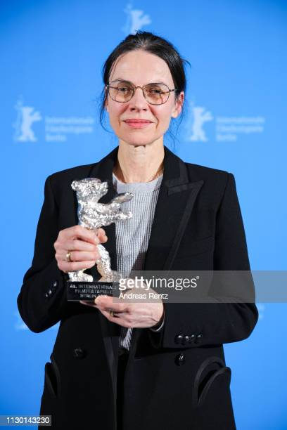 Angela Schanelec winner of the Silver Bear for Best Director for I Was at Home But poses backstage at the closing ceremony of the 69th Berlinale...