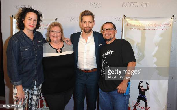Angela Sheton and ShawnCaulin Young with guests arrive for the premiere of 'Heart Baby' held at The Ahrya Fine Arts Laemmle Theater on November 23...