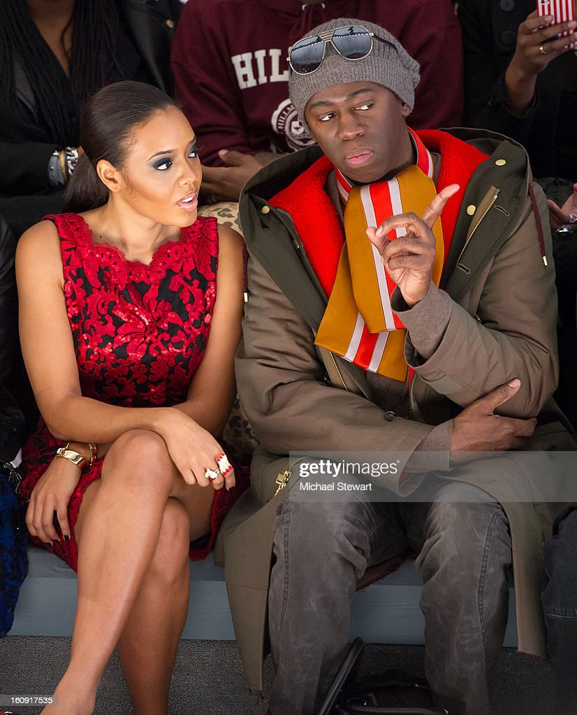 Angela Simmons (L) and tv personality J Alexander attend Tadashi Shoji during Fall 2013 Mercedes-Benz Fashion Week at The Stage at Lincoln Center on February 7, 2013 in New York City.