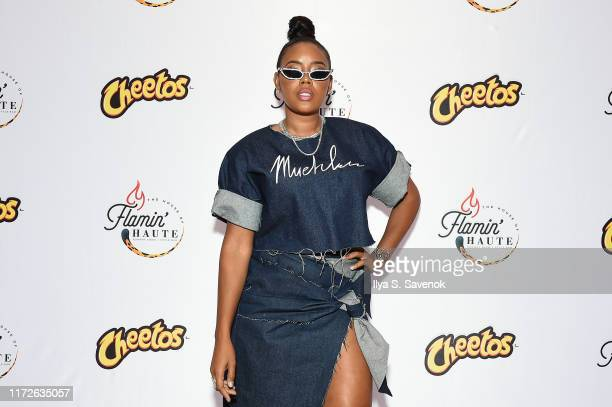 Angela Simmons attends as Cheetos unveiled faninspired versions of the #CheetosFlaminHaute look at The House Of Flamin' Haute Runway Show Style Bar...