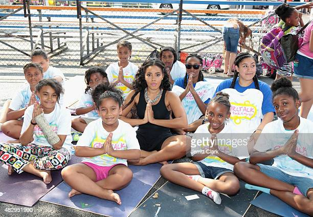 Angela Simmons does Yoga with the youth during GirlTalk Takeover Hosted By Angela Simmons at Harlem Boys and Girls Club on July 29 2015 in New York...