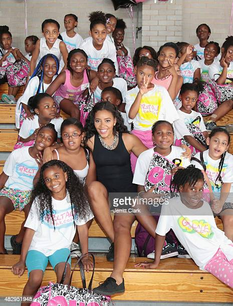 Angela Simmons poses for a photo with the youth participating in the GirlTalk Takeover Hosted By Angela Simmons at Harlem Boys and Girls Club on July...