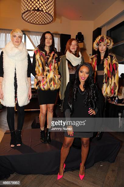 Angela Simmons poses with models at the launch of Foofi By Angela Simmons at Gansevoort Hotel on March 16 in New York City