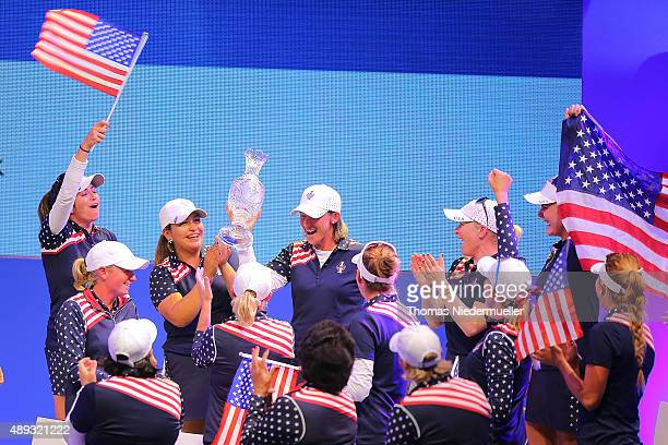 Angela Stanfor of the Unitedt States Team shows the trophy during the closing ceremony at the 2015 Solheim Cup at St LeonRot Golf Club on September...
