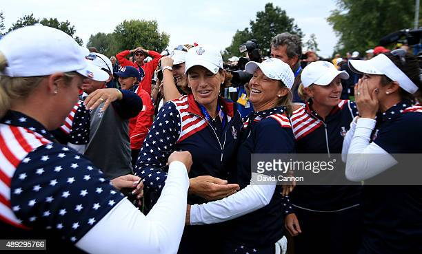 Angela Stanford of the United States is congratulated by her captain Juli Inkster after Stanford had beaten Suzann Pettersen by 21 to secure a vital...