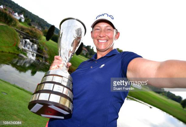 Angela Stanford of the United States poses as if she was taking a selfie photograh with the Evian Championship Trophy after victory in the compeition...