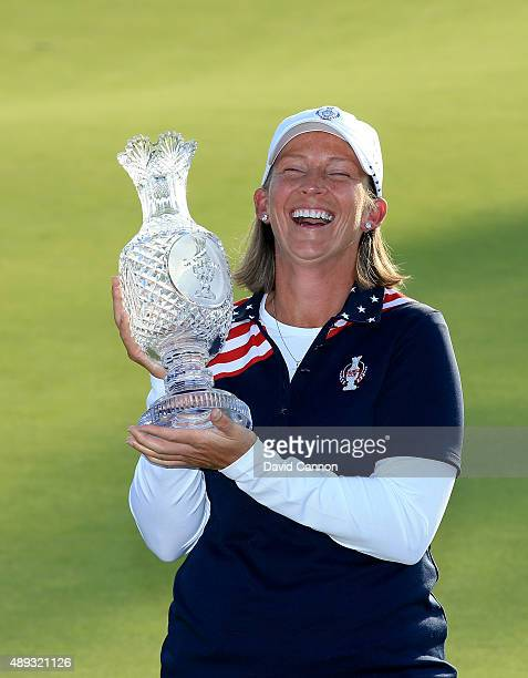 Angela Stanford of the United States Team proudly holds the Solheim Cup trophy after the closing ceremony during the final day singles matches in the...