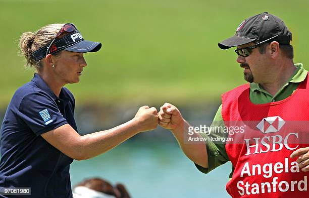 Angela Stanford of the USA celebrates with her caddie after her birdie on the seventh hole during the second round of the HSBC Women's Champions at...