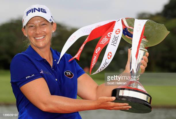 Angela Stanford of the USA celebrates with the trophy after winning the HSBC Women's Champions on the third playoff hole during the final round of...