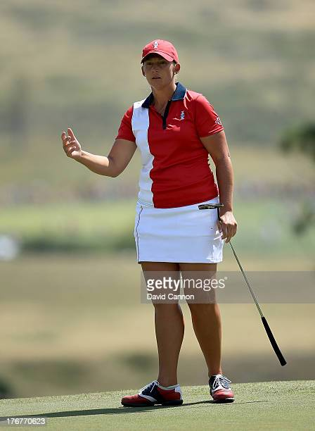 Angela Stanford of the USA on the green at the first hole during the final day singles matches in the 2013 Solheim Cup at The Colorado Golf Club on...