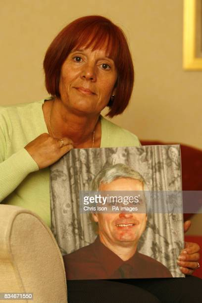Angela Syder holds a photograph of her late husband Glenn who was knocked off his bicycle and killed as he rode to work in Fareham Hampshire in...