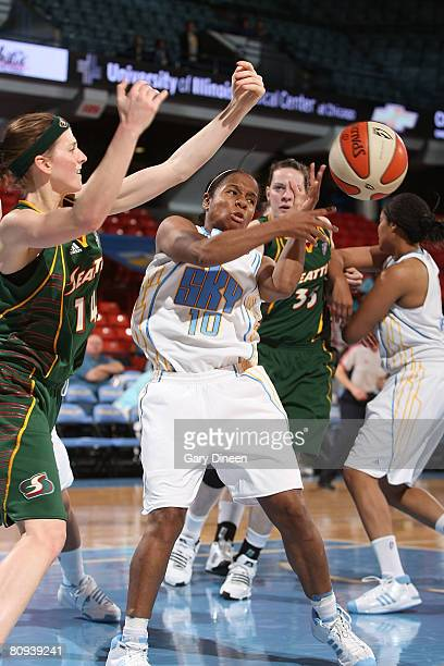 Angela Tinsdale of the Chicago Sky goes for the ball with Allie Quigley and Natalie Doma of the Seattle Storm during the WNBA game on April 30 2007...