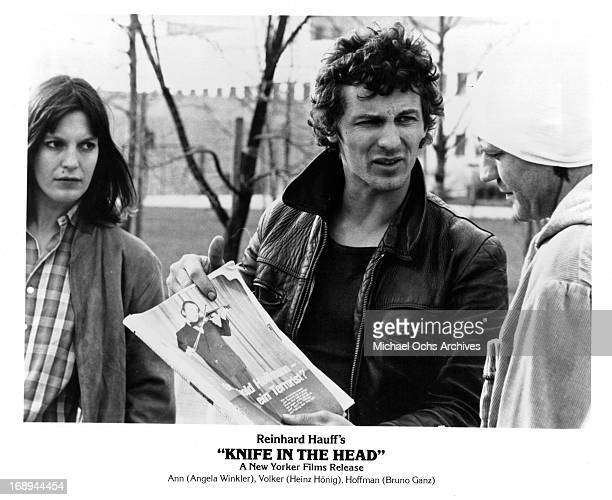 Angela Winkler and Heinz Hoenig stop Bruno Ganz in a scene from the film 'Knife In The Head' 1978