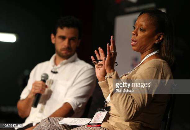 Angela Woods Senior Director Corporate Citizenship at ESPN talks with Mano Silva COO lovefutbol during a Beyond Sport United Conference at NYU on...