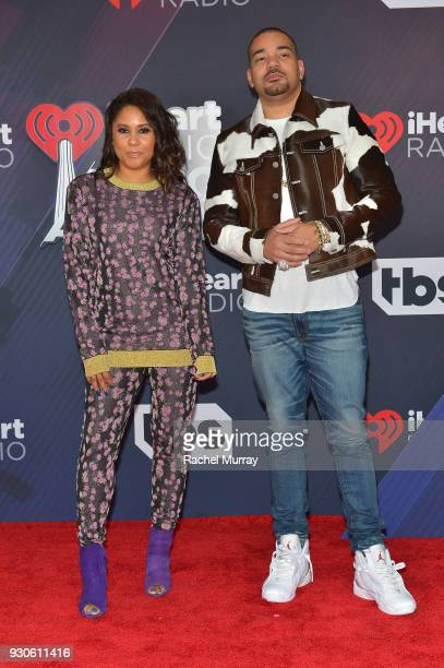 Angela Yee and DJ Envy arrive at the 2018 iHeartRadio Music Awards which broadcasted live on TBS TNT and truTV at The Forum on March 11 2018 in...