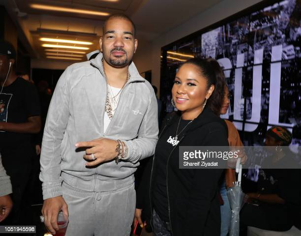 Angela Yee and DJ Envy attend Sean John x Bloomingdale's Cocktail Party at Bloomingdale's on October 11 2018 in New York City