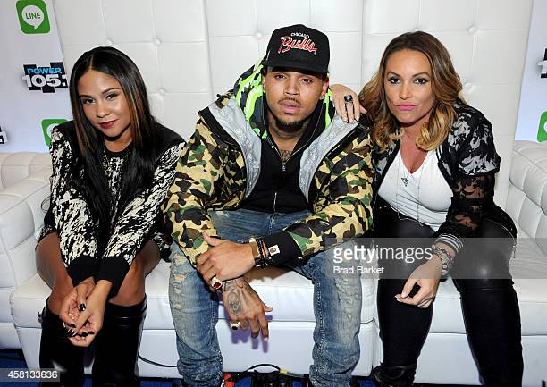 Angela Yee Chris Brown and Angie Martinez speak backstage at Power 1051's Powerhouse 2014 at Barclays Center of Brooklyn on October 30 2014 in New...