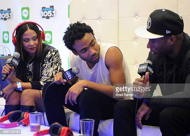 Angela Yee Donald 'Childish Gambino' Glover and Charlamagne Tha God speak backstage at Power 1051's Powerhouse 2014 at Barclays Center of Brooklyn on...