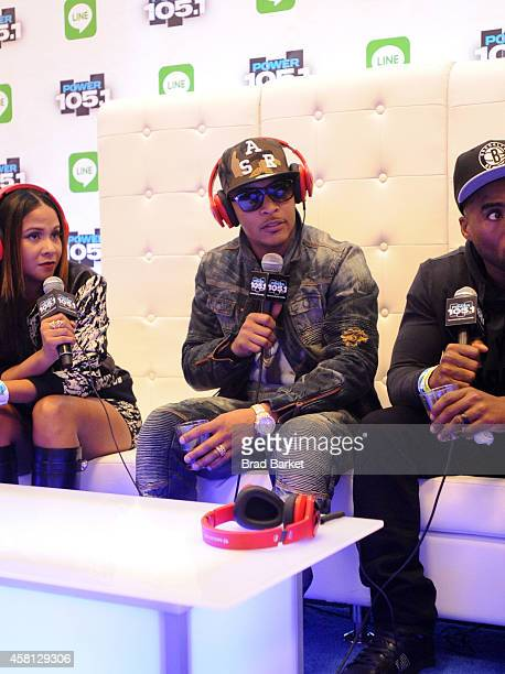 Angela Yee TI and Charlamagne Tha God speak backstage at Power 1051's Powerhouse 2014 at Barclays Center of Brooklyn on October 30 2014 in New York...