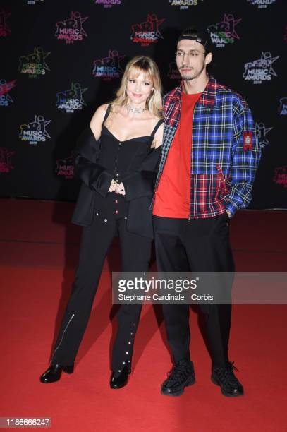 Angele and Romeo Elvis attend the 21st NRJ Music Awards At Palais des Festivals on November 09, 2019 in Cannes, France.