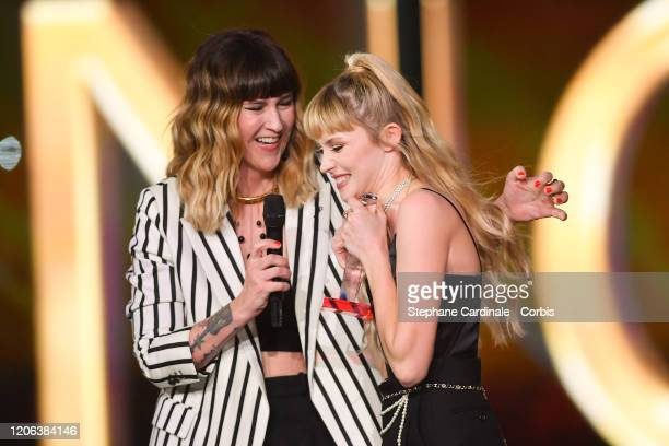 Angele Van Laeken aka Angele celebrates after receiving the best live show award next to Daphne Burki during the 35th 'Les Victoires De La Musique'...