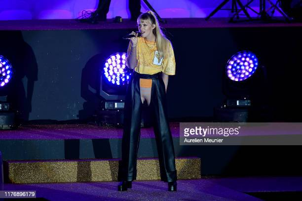 Angele van Laeken performs during the Etam Winter 2019/Summer 2020 show as part of Paris Fashion Week At Roland Garros on September 24 2019 in Paris...