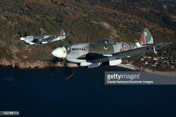angelholm, sweden - supermarine spitfire mk. xviii and mk. xvi fighter warbirds. - spitfire stock photos and pictures