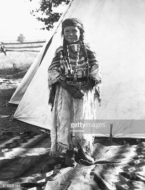 Angelic La Moose whose grandfather was a Flathead Chief wearing a costume her mother made fulllength standing in front of a tent Flathead Reservation...