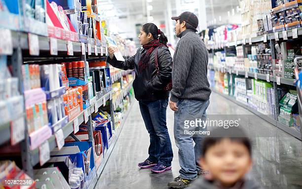 Angelica Aguillon left and Victor Argueta shop inside a BJ's Wholesale Club store in Falls Church Virginia US on Thursday Dec 30 2010 BJ's Wholesale...