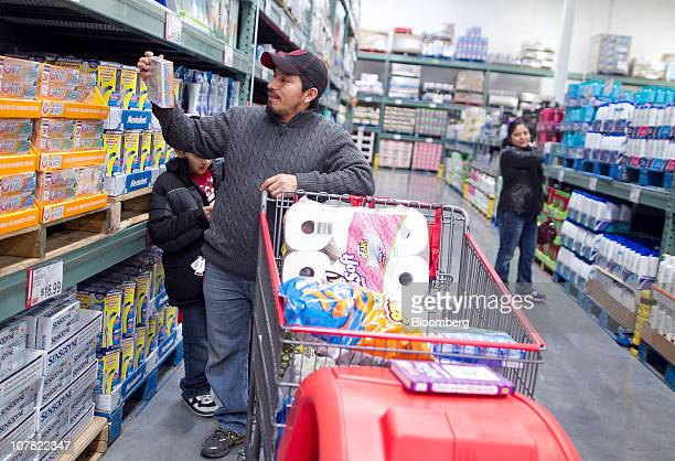 Angelica Aguillon right and Victor Argueta shop inside a BJ's Wholesale Club store in Falls Church Virginia US on Thursday Dec 30 2010 BJ's Wholesale...