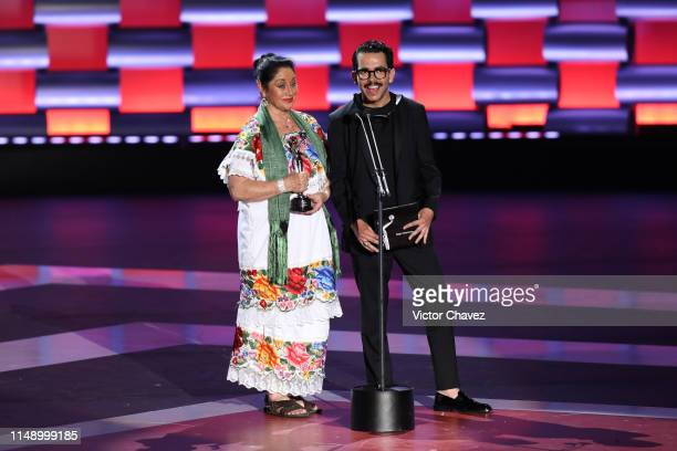 Angelica Aragon and Manolo Caro speak on stage during the Premios Platino 2019 at Occidental Xcaret Hotel on May 12 2019 in Playa del Carmen Mexico